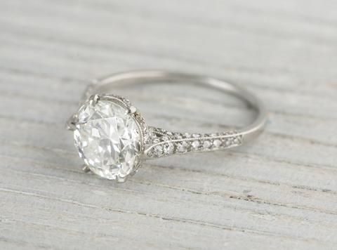 This J.E. Caldwell & Co. Art Deco vintage engagement ring is made in platinum and centered with a 2.04 carat GIA certified old European cut diamond with I color and SI2 clarity. Light as a feather on the finger. Circa 1920 Center diamond is set in a six prong setting, which in the most elegant way, floats the diamond up, allowing light to shine through and enliven the stone. Enhanced by sheaths of the sweetest little single cut diamonds! Learn more about Art Deco rings Diamond and gold…