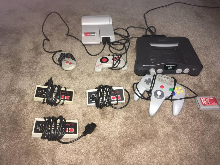 Found a box full of games and 2 Nintendo consoles from when I was younger. I believe the NES is the NES-101 Control Deck