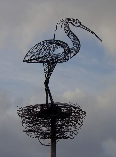 'The Carmyle Heron', by the acclaimed Glasgow artist, Andy Scott. It is located on the Clyde Walkway, adjacent to the River Clyde, between Carmyle and Cambuslang, Glasgow area.