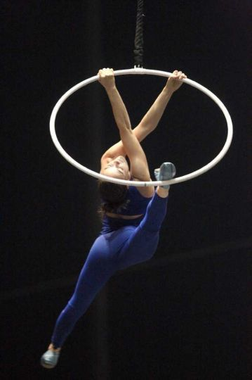 Performer Julie Cameron practices the aerial hoops for Cirque du ...