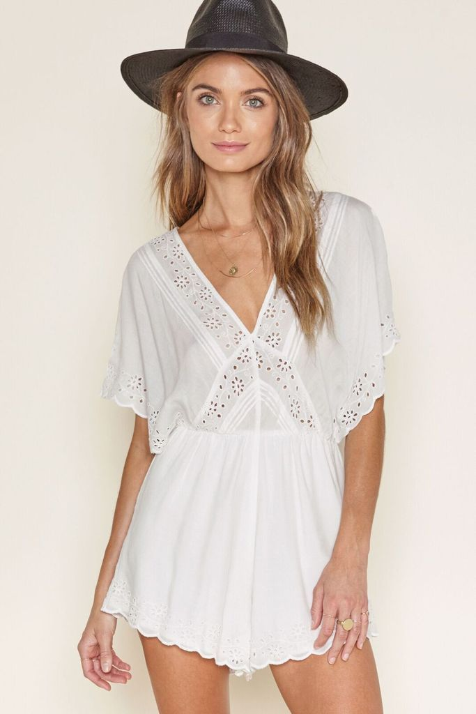 Anderson Romper from Amuse Society is a white romper with lace detail and lined shorts.