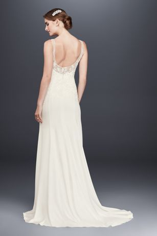 1b01579528 This chic stretch-crepe sheath wedding gown features airy illusion tank  straps