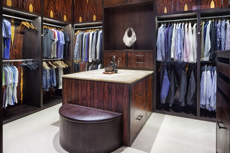 The master suite includes his and hers walk-in closets. The island has an onyx countertop.