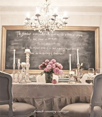 Dining in style! Love the drop cloth tablecloth and the peonies in a simple vase.
