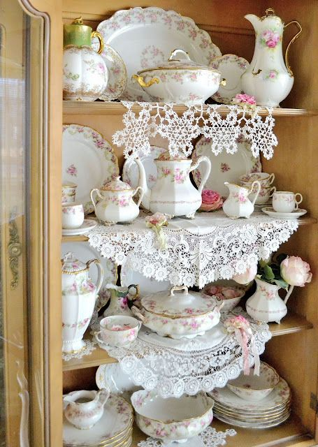 An entire cabinet full of stunning pink rose china...love it and the lace!!