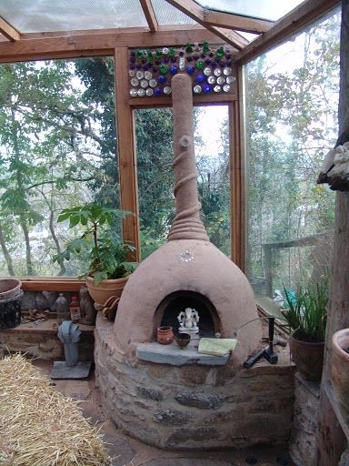 This cob fireplace-rocket stove, can keep your greenhouse warmer in those cold winter months.