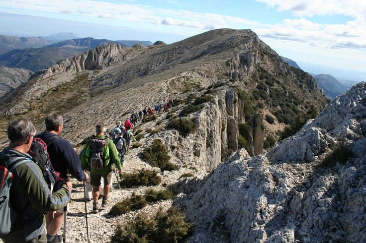 There is a large group of people who meet twice a week to enjoy mountain hiking in the Costa Blanca region of Spain.