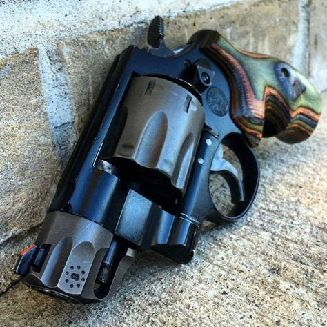 Smith & Wesson Revolver. I love the wooden handle on this. I cant wait until im old enough to get my Concealed Carry Permit