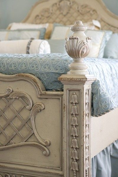 Beautiful blue bedding  and wooden bed Inspiration Lane