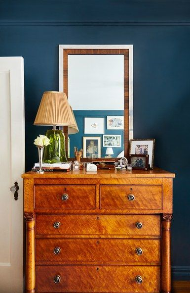 """Of the striking burl wood chest in her bedroom, James explains, """"It was my first 'big girl' purchase in my early 20s and has made the move cross-country with me to NYC. It was the one item I was adamant come with me."""" 