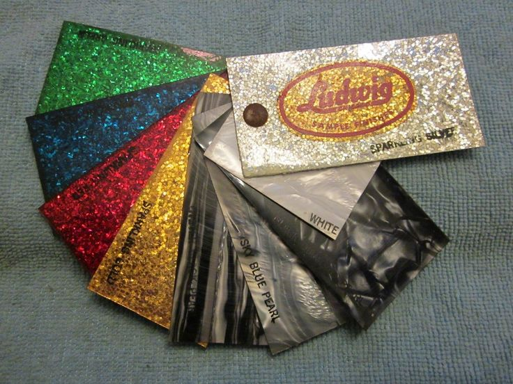 Music dealership sample cards displaying 1960s Ludwig pearl and sparkle drum wrap finishes