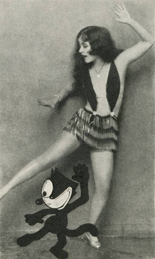 Ann Pennington teaching Felix the Cat how to dance the black bottom.  Photoplay magazine (1927)
