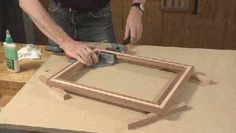 Learn how to cut and assemble your picture frame moldings using a specialized sled and 90-degree corner clamps.