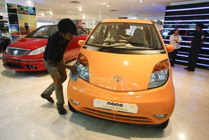 India's Tata Motors defends strategy for $1500 Nano car #Business_ #iNewsPhoto