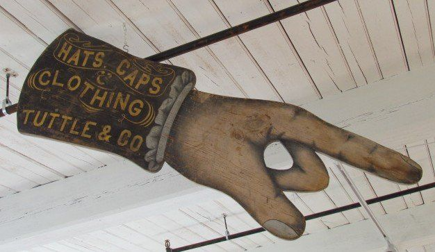"""Antique """"Tuttle & Co. Clothing"""" Pointing Hand Trade Sign"""