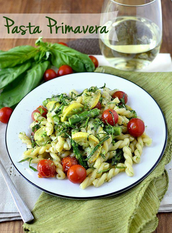 Springtime Pasta Primavera is a light pasta dish full of fresh vegetables, tossed in a luscious sauce. | iowagirleats.com