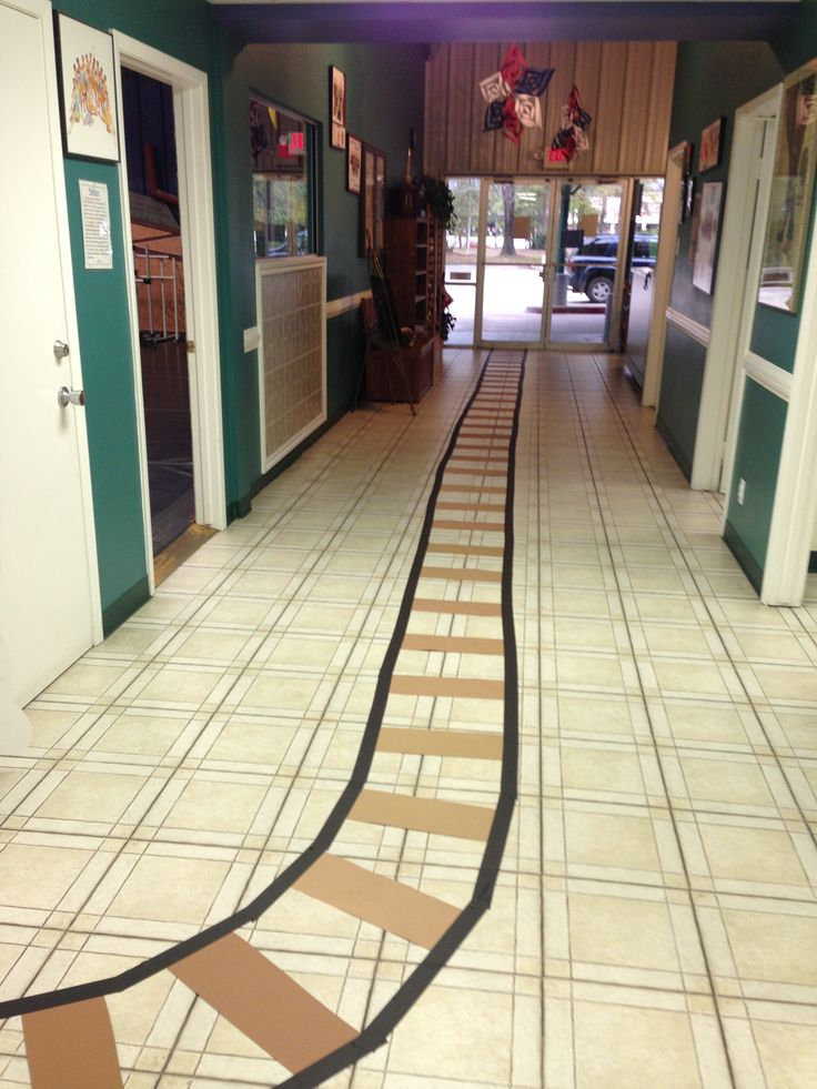 Polar express day. Train track on floor at school. Maybe a butcher paper train on the wall too? Or one they can walk through?