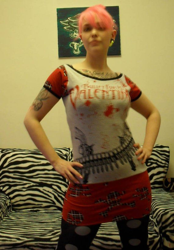This was a pretty cool tee as it was, but it upcycled into a really cute dress! Skirt and sleeves of red fabric with tartan skulls, edged around the