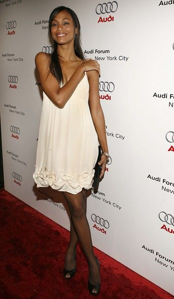 Zoe Saldana Photos Photos - Zoe Saldana poses on the red carpet for the debut celebration for Audi's Sports Car, the R8, held at the opening of the first United States-based Audi Forum, located at the corner of Park Avenue and 47th Street October 10, 2006 in New York City. - Audi Celebrates R8 Debut & Audi Forum