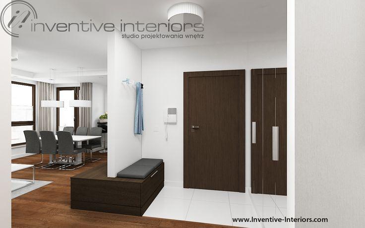 Projekt przedpokoju Inventive Interiors - siedzisko połączone z szafką rtv