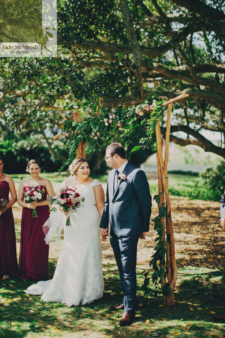 Our natural timber arbour adorned with lush green foliage and vines with pops of peach and pink. www.jademcintoshflowers.com.au www.davidrobertson.com.au