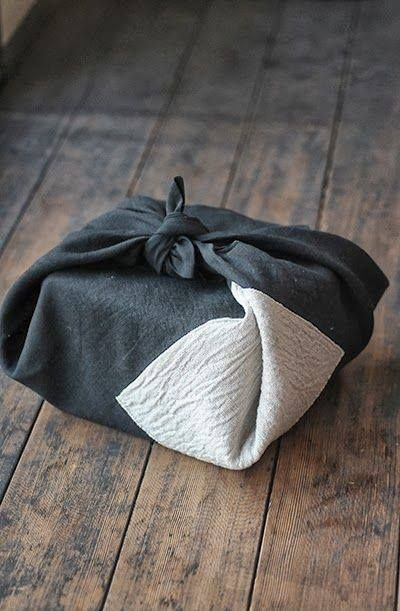 Japanese wrapping cloth, Furoshiki 風呂敷  Light packages and items being taken when visiting another home are generally wrapped in a Furoshiki ~                         my understanding of the custom is that the furoshiki is left with the package when visiting.