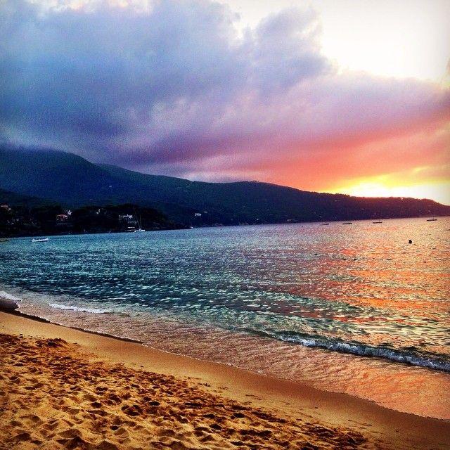 Sunset at Elba Island in Italy. Photo courtesy of livinginthemomentblog on Instagram.