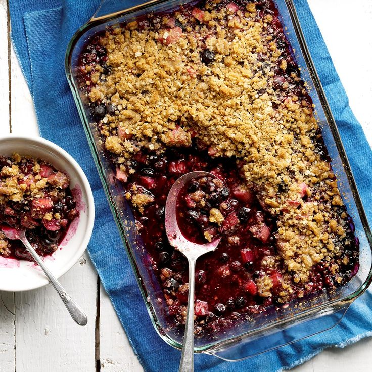 Blueberry-Rhubarb Crumble Recipe -A dollop of whipped topping adds a nice finishing touch to this satisfying crumble. Sometimes I drizzle a little flavored coffee creamer on top instead of the whipped topping. —Nancy Sousley, Lafayette, Indiana