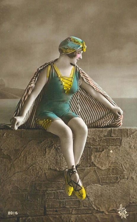 Interesting lace-up bathing costume with matching lace up beach shoes, 1920s hand-tinted postcard.