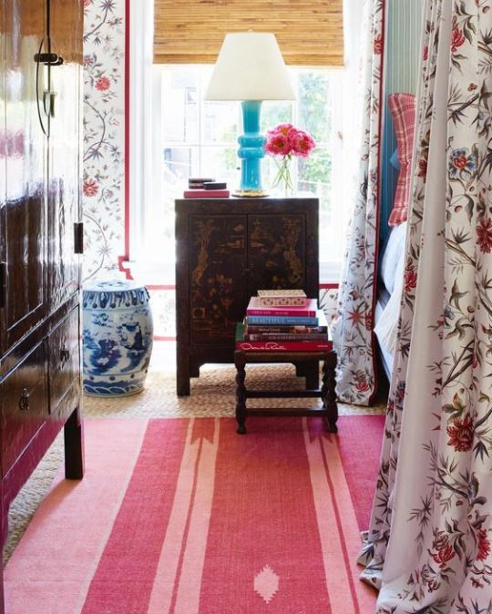 Color Outside the Lines: Paule Marrot - Jumping Off of a Bridge - Fabulous bedroom with a pretty chintz and raspberry flatweave rug - and Chinoiserie furnishings by Mark D. Sikes