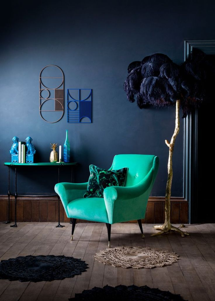 The Matthew Williamson Tango chair in Estelle Teal is positioned in between a purple ostrich feather lamp and a flamingo console table. Introducing Matthew Williamson's first ever bespoke furniture collection. Created in collaboration with Nottingham-based sofa manufacturer Duresta, the designs comprise five upholstery ranges and unique occasional pieces.