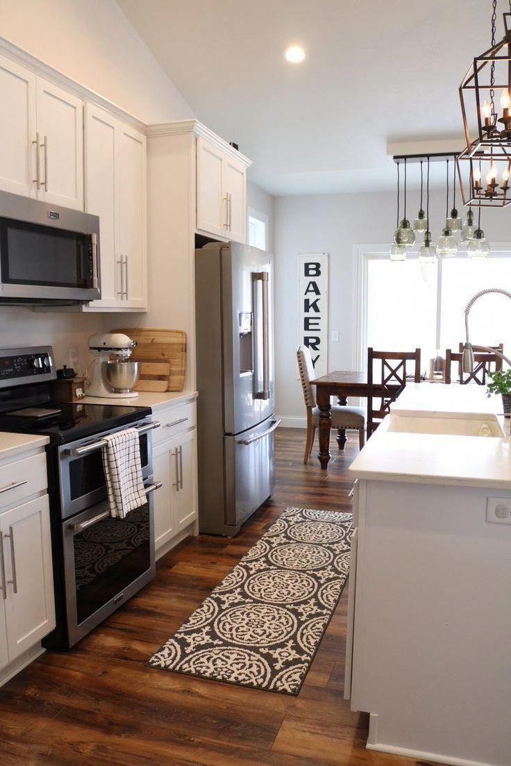 Although picking a new set of kitchen cabinets might ...