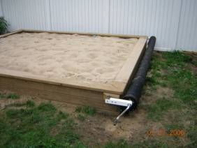 SANDigz sandbox cover design is so simple our 2 year old child can open this huge 10 foot x 12 foot sandbox and play.  Not only is it easy to operate, the cover keeps the sand clean and cats out!  Sandbox design #plans that include all you need to know about this #reel in cover can be found at: https://SANDigz.com
