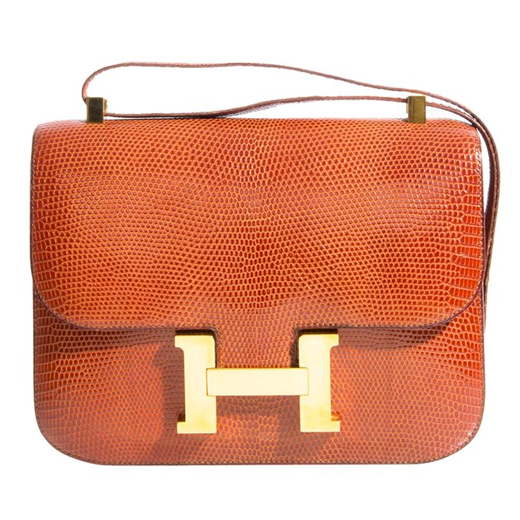 THE HERMES CONSTANCE 23CM COMES IN EXTREMELY RARE COGNAC LIZARD.