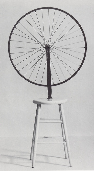 Marcel Duchamp - 'Bicycle Wheel' - 1913. This was his first Ready-made and was created by repositioning a bicycle wheel on a stool, signing it and then calling it art, this is a very postmodern approach to design as it causes the viewer to question what constitutes art. (Postmodernism and Appropriation)