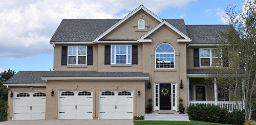 exterior house paint color combinations | Large home painted with 3 colors; tan stucco, cream trim and black ...