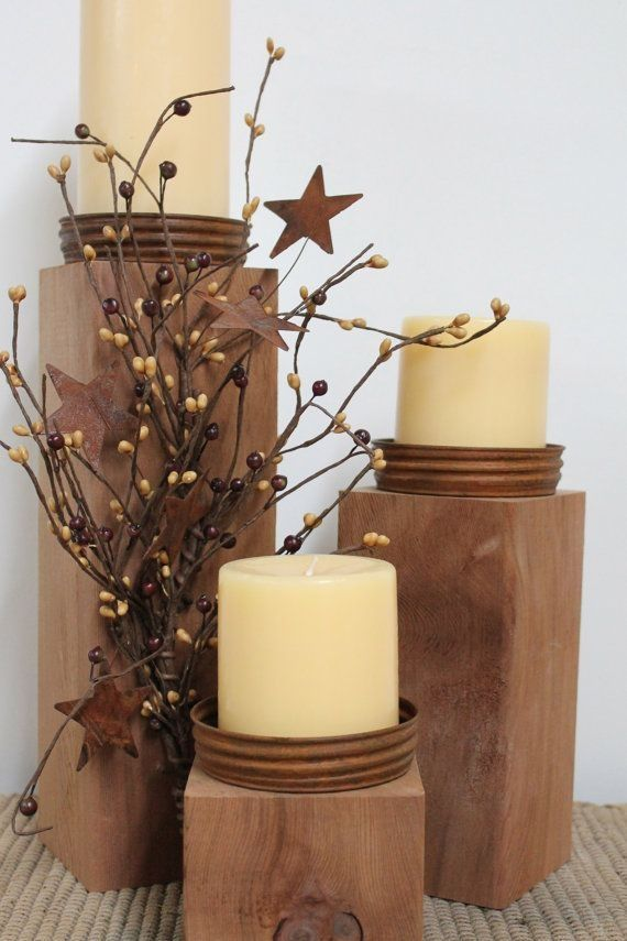 Candle with wood pillars and metal lids. I love this!!