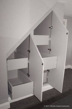 This look is a little to modern for our house, but add the library trim exterior to this organized interior under the stairs and you have a perfect combo.