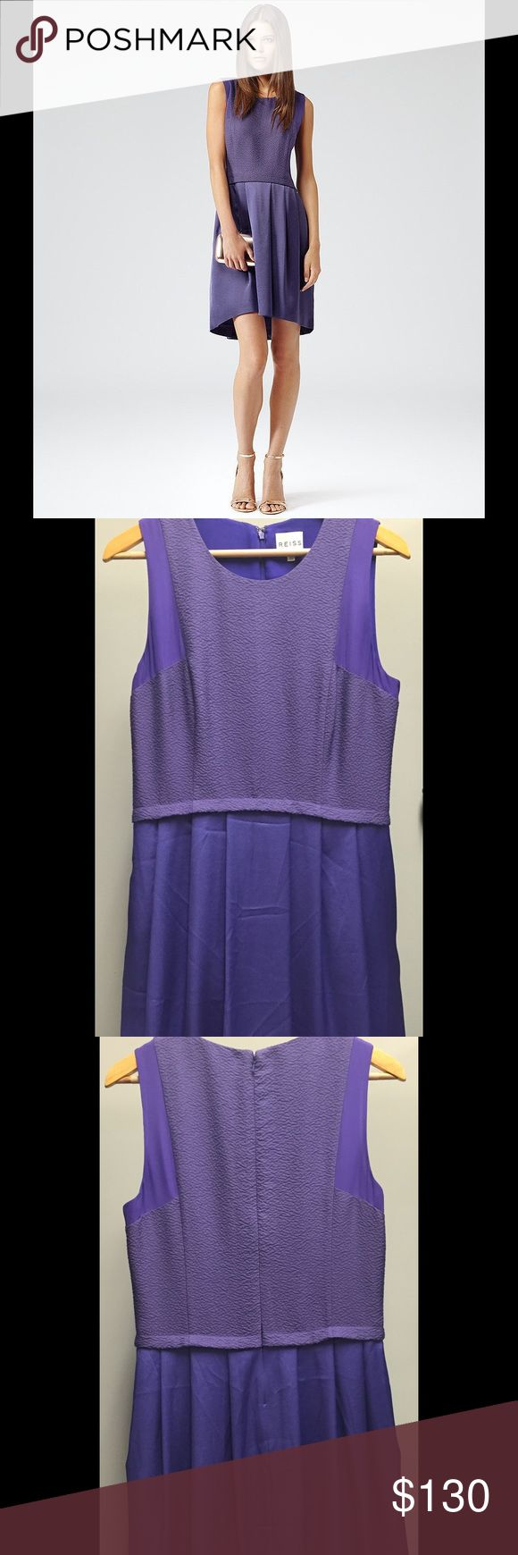 REISS purple textured Gigi dress (EUC!) Only worn a handful of times, this gorgeous REISS dress is in excellent used condition with no damage! Only wrinkles in pics. Dress features a purple textured bodice with silk trim and back zip and hook eye closure. Dress has slight hi-lo cut as shown on model and great movement. Purchased in a London Reiss store it is UK size 12/ US 8. Love this dress! Not quite sure I'm ready to let it go, but we'll see. Smoke free and pet free household. Reiss…