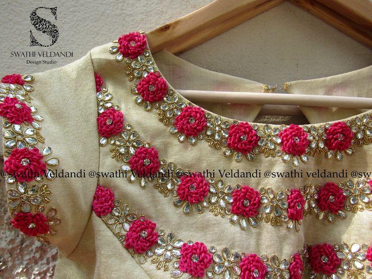 Beautiful boat neck designer blouse with hand embroidery thread and kundan work from Swathi Veldandi.
