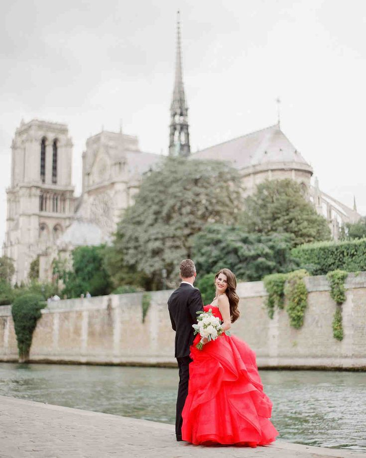 A Glamorous Destination Wedding in Paris | Martha Stewart Weddings - Paris provided a variety of photo opportunities such as the storied Notre-Dame Cathedral.