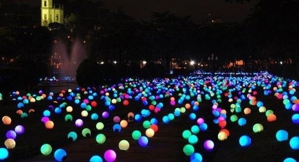 Glow sticks in balloons, all over beach for after party