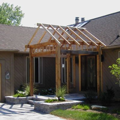 This Cedar Pergola Was Installed On A Front Entrance To A