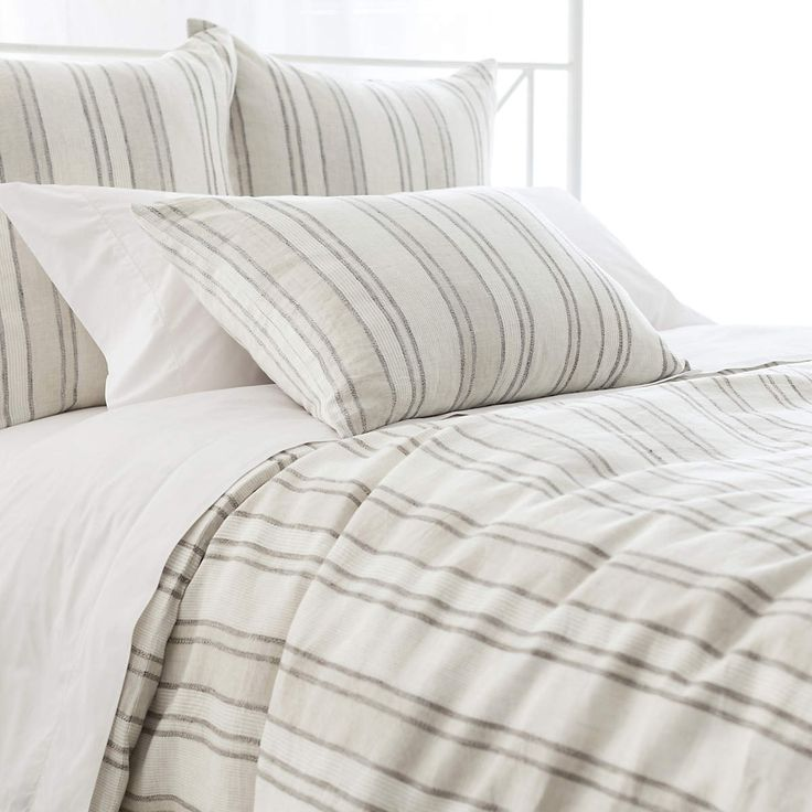In versatile neutrals and classic ticking stripes, this tailored linen duvet cover is a natural in the master bedroom, guest room, or vacation house! Crafted to be an exact color match for our Keaton Linen Natural duvet and shams. • 100% linen. • Vertical stripes. • Knife edge. • Hidden button closure.
