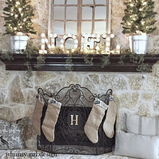 whimsy girl: Holiday House Walk {Part 1} Lit topiaries, Christmas mantle décor, Noel marquee sign, burlap stockings, stone fireplace.