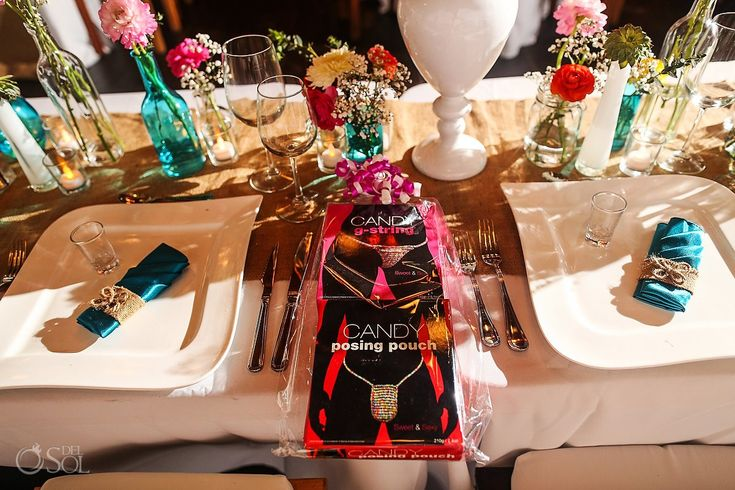 Table set up wedding Akiin Beach Club Tulum destination wedding, love the risque party favours! :D Mexico wedding photographers Del Sol Photography