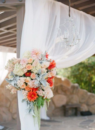 orange mixed with pastels Photography by lanedittoe.com |  Event Planning by amberweir.com |  Floral Design by ninakincaiddesigns.blogspot.com | Read more - http://www.stylemepretty.com/2013/06/10/heartstone-ranch-wedding-from-amber-weir-event-design-lane-dittoe/