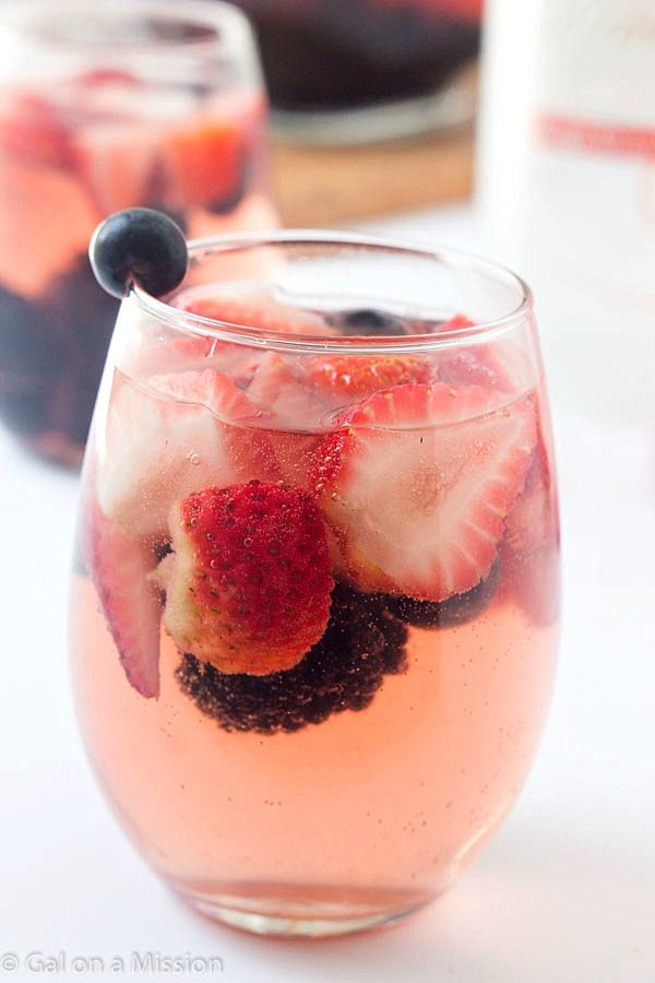 With the warmer weather, we all want a glass of sangria, especially with mixed berries! This really is one of the easiest sangria recipes out there. You can also call it a sangria white because it utilizes white wine, or even a sangria punch when different wines are mixed together! You are going to love it, I promise.