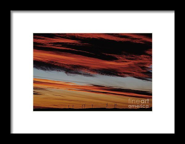 Wind Turbines Farm In The Distance On Beautiful Red, Orange And Blue Sunset Framed Print