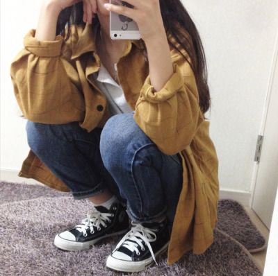 ★★★★four stars (mustard trench coat cuffed sleeves, white tee, medium wash skinny jeans, black high top converse)